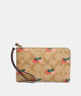 CORNER ZIP WRISTLET IN SIGNATURE CANVAS WITH STRAWBERRY PRINT