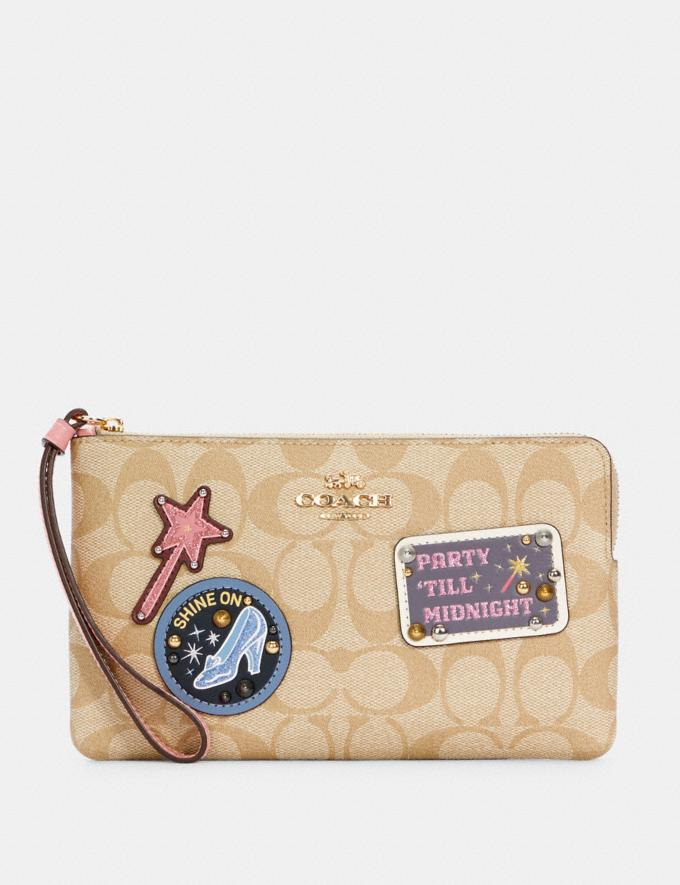 DISNEY X COACH LARGE CORNER ZIP WRISTLET IN SIGNATURE CANVAS WITH PATCHES