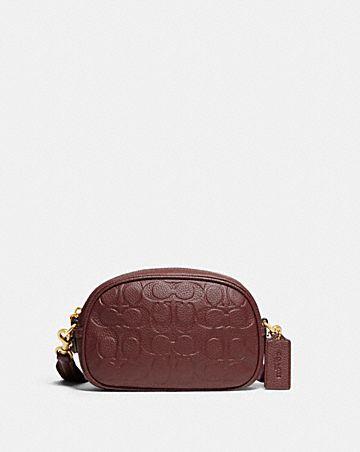 camera crossbody in signature leather