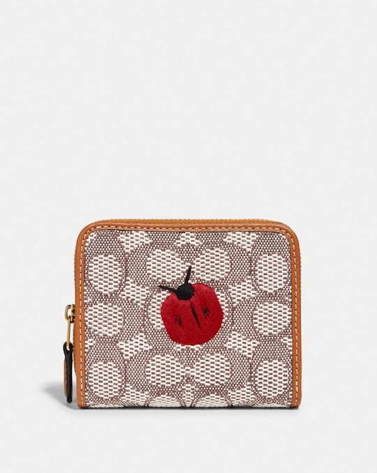 BILLFOLD WALLET IN SIGNATURE TEXTILE JACQUARD WITH LADYBUG MOTIF EMBROIDERY