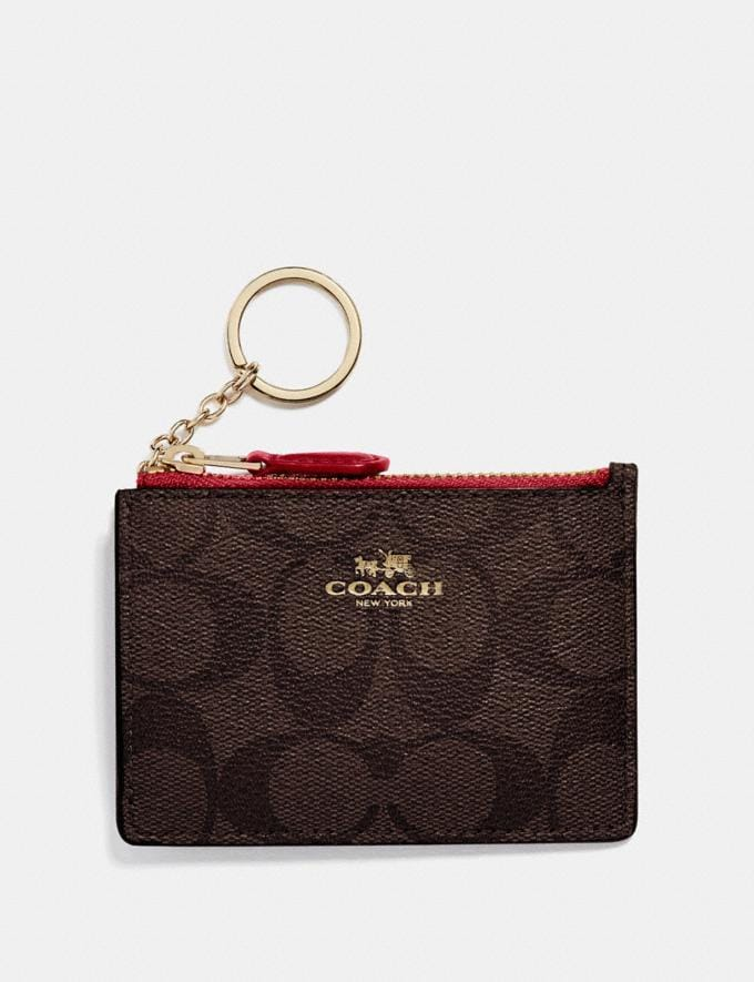 Coach Mini Skinny Id Case in Signature Canvas Brown/True Red/Light Gold Women Bag Charms & Accessories