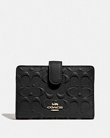 medium corner zip wallet in signature leather