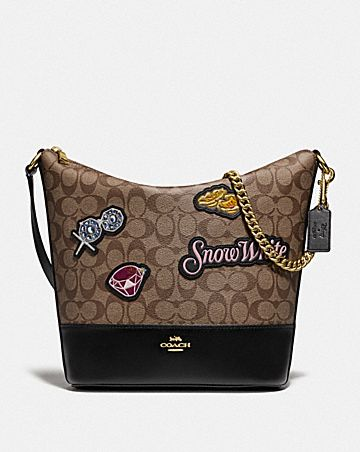 DISNEY X COACH PAXTON DUFFLE IN SIGNATURE CANVAS WITH SNOW WHITE