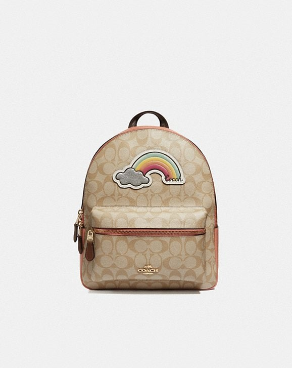 Coach MEDIUM CHARLIE BACKPACK IN SIGNATURE CANVAS WITH RAINBOW MOTIF
