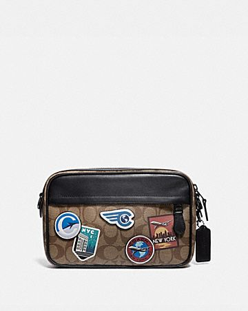 GRAHAM CROSSBODY IN SIGNATURE CANVAS WITH TRAVEL PATCHES
