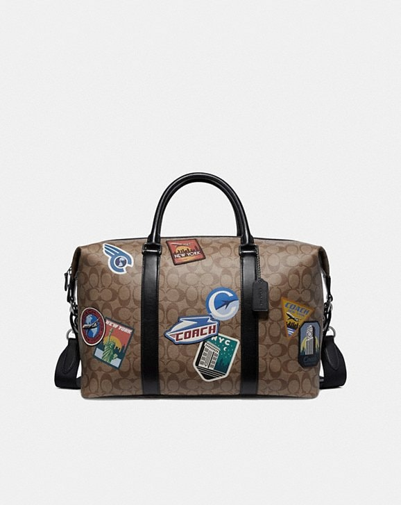 Coach VOYAGER BAG IN SIGNATURE CANVAS WITH TRAVEL PATCHES