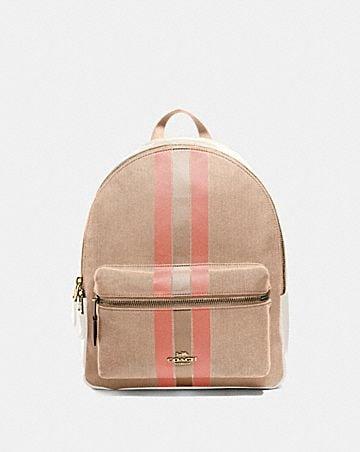 medium charlie backpack in signature jacquard with varsity stripe