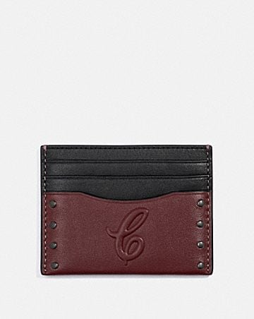 slim card case with signature motif and studs