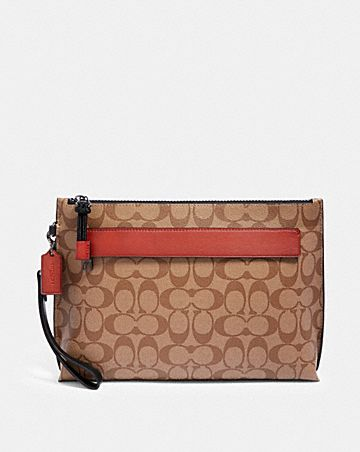 carryall pouch in colorblock signature canvas