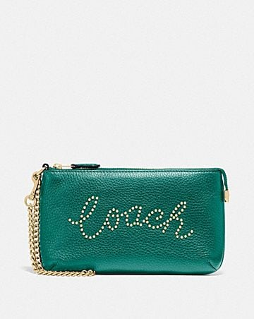 large wristlet with studded coach script