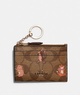 MINI SKINNY ID CASE IN SIGNATURE CANVAS WITH PARTY ANIMALS PRINT