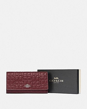 boxed trifold wallet in signature leather