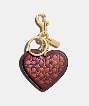 SIGNATURE STRIPE HEART BAG CHARM