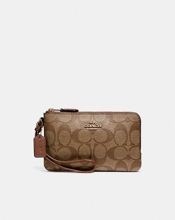 Coach DOUBLE CORNER ZIP WRISTLET IN SIGNATURE CANVAS