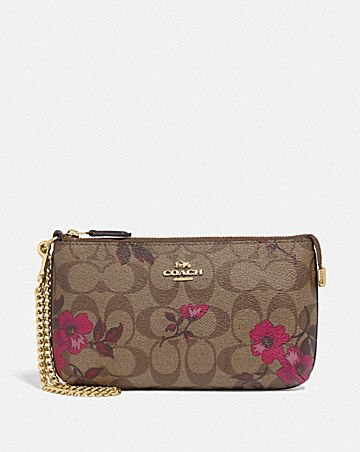 large wristlet in signature canvas with victorian floral print