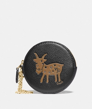 ROUND COIN CASE WITH CAPRICORN