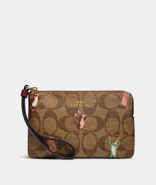 CORNER ZIP WRISTLET IN SIGNATURE CANVAS WITH PARTY ANIMALS PRINT
