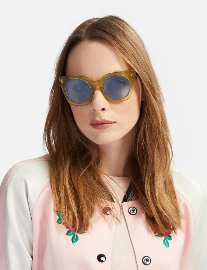Coach Horse and Carriage Hologram Sunglasses Yellow Translucent/Light Blue Solid Women Accessories Sunglasses Alternate View 1